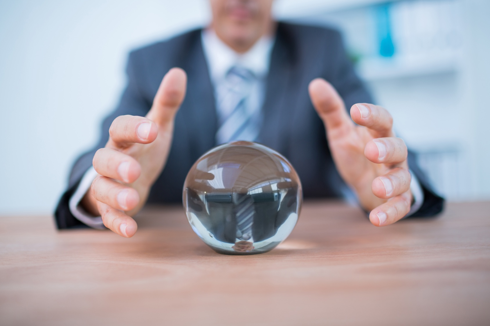 Businessman forecasting with crystal ball