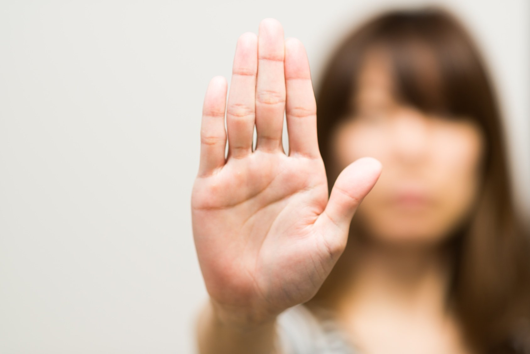 Woman holding her hand up, objecting